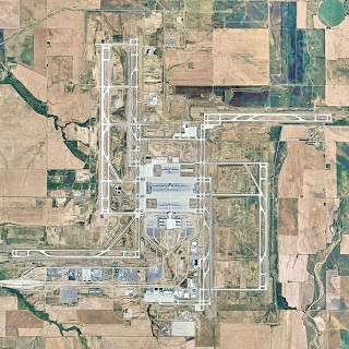 An aerial view of the Denver Airport. An airport that didn't even need to be built. And is shaped like a Nazi