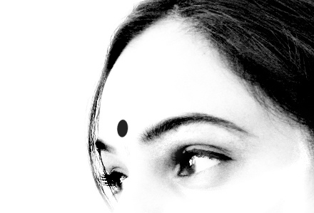 THE HINDU THIRD EYE, AS REPRESENTED BY BELIEVERS AS A SYMBOL ON THE CENTER OF THEIR FOREHEAD.
